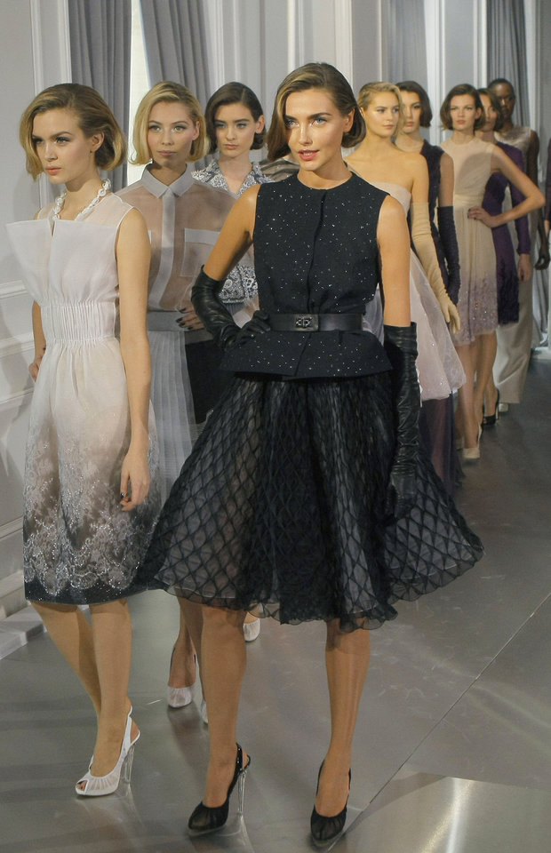 Models wear creations by British fashion designer Bill Gaytten  as part of his Dior Spring-Summer 2012 Haute Couture fashion collection for women presented Monday in Paris. AP PHOTO <strong>Jacques Brinon - AP</strong>
