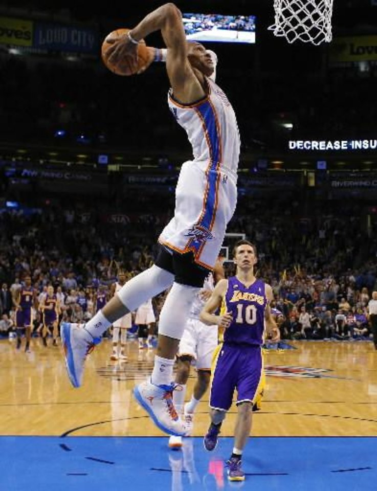 Oklahoma City's Russell Westbrook (0) goes up for a dunk as Los Angeles' Steve Nash (10) watches during an NBA basketball game between the Oklahoma City Thunder and the Los Angeles Lakers at Chesapeake Energy Arena in Oklahoma City, Tuesday, March. 5, 2013. Photo by Bryan Terry, The Oklahoman Archives