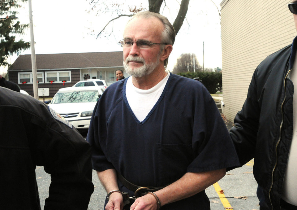 FILE -- In a Dec. 11, 2012, file photo, retired Pennsylvania pastor Arthur Schirmer is lead away from the Lebanon County Courthouse after a preliminary hearing in Lebanon, Pa. Schirmer is charged with killing both of his wives and is on trial in the death of his second wife. (AP Photo/Lebanon Daily News, Earl Brightbill) THE PATRIOT-NEWS OUT