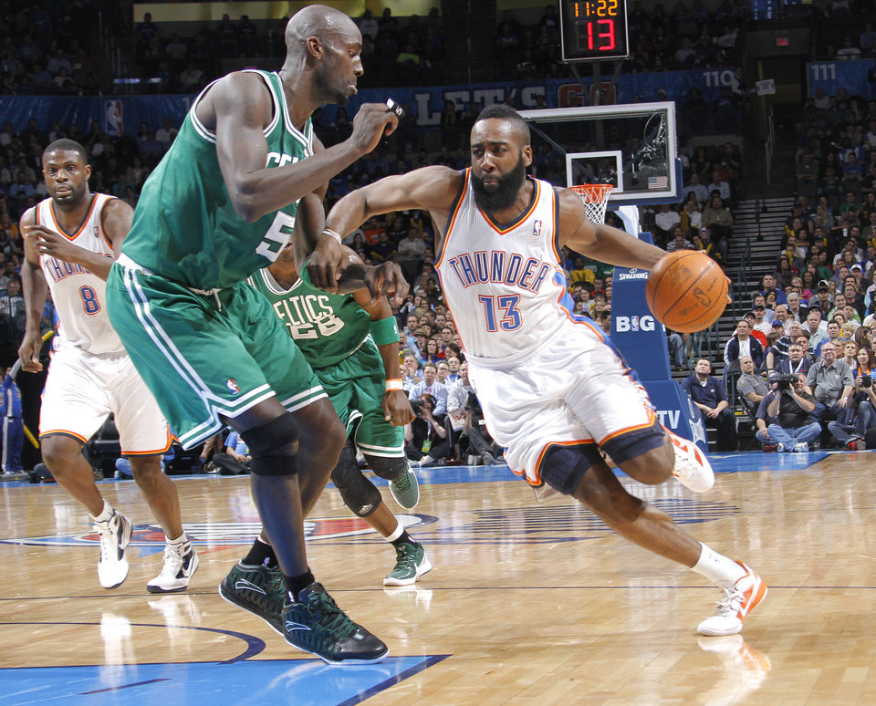 Photo - Oklahoma City Thunder guard James Harden (13) drives past Boston Celtics power forward Kevin Garnett (5) during the NBA basketball game between the Oklahoma City Thunder and the Boston Celtics at the Chesapeake Energy Arena on Wednesday, Feb. 22, 2012 in Oklahoma City, Okla.  Photo by Chris Landsberger, The Oklahoman