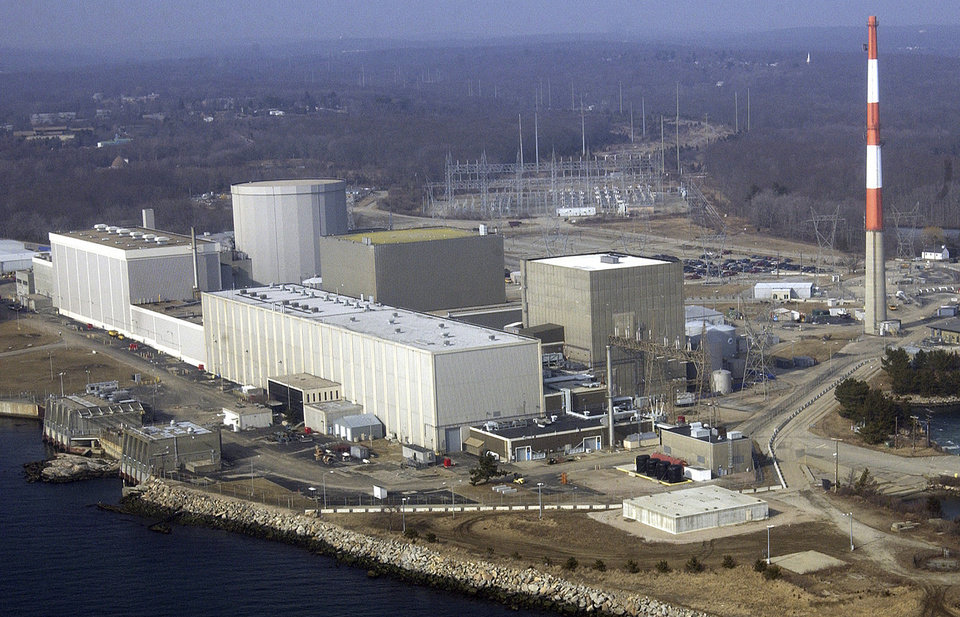 FILE - This March 18, 2003 aerial file photo shows the Millstone nuclear power facility in Waterford, Conn. The nuclear plant is preparing to ask federal regulators for permission to use water that's even warmer than the temperature that forced it to shut a unit in August 2012. (AP Photo/Steve Miller, File)