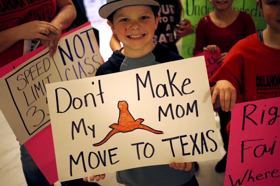 Photo - Cade Atchley, a second grader from Locust Grove, Oklahoma, holds a sign as he joins teachers from the school and other students at the Oklahoma State Capitol in Oklahoma City on Tuesday, March 20, 2018. Teachers from around the state lobbied their legislators on Tuesday. JOHN CLANTON/Tulsa World