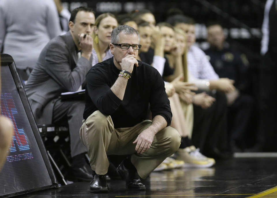 Photo - Idaho head coach Jon Newlee looks on during the second half of an NCAA tournament first-round women's college basketball game against Louisville, Sunday, March 23, 2014, in Iowa City, Iowa. Louisville won 88-42. (AP Photo/Charlie Neibergall)