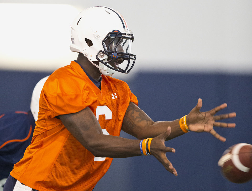 Photo - Auburn quarterback Jeremy Johnson reaches for the ball during an NCAA college football practice Friday, Aug. 1, 2014, in Auburn, Ala. (AP Photo/Brynn Anderson)