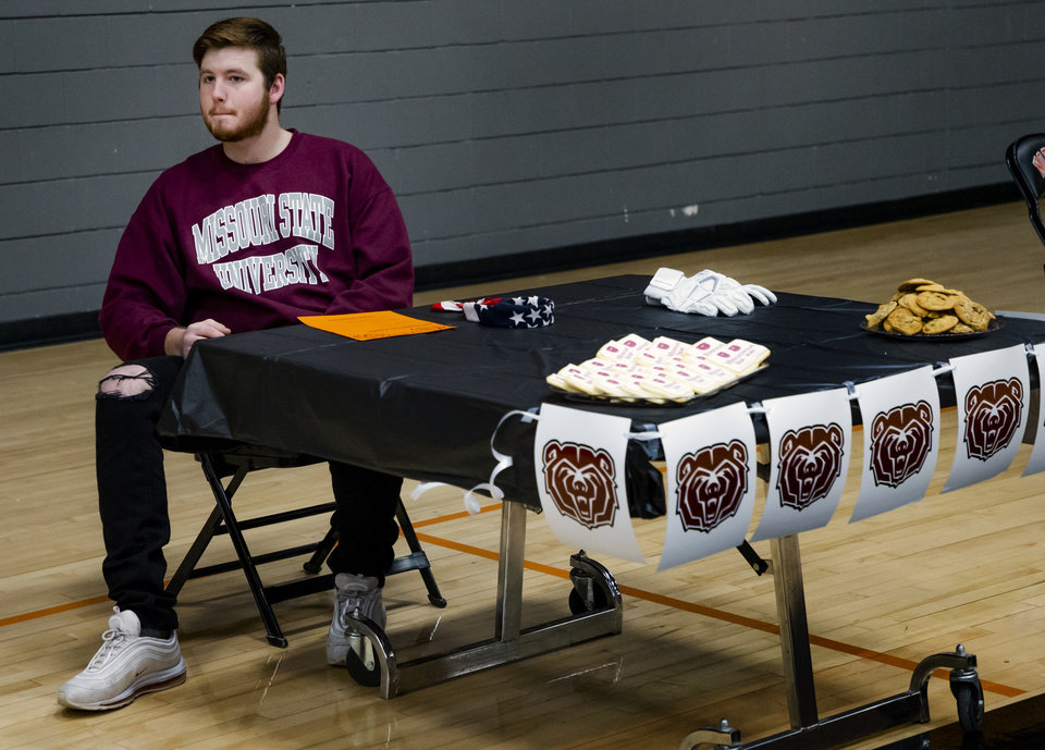 Photo - Missouri State University signee Grant Goodson waits for the start of a national signing day ceremony for football at Norman High School in Norman Okla. on Wednesday, Dec. 18, 2019.   [Chris Landsberger/The Oklahoman]