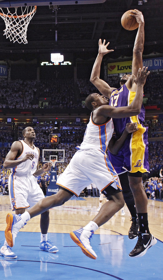 Photo - Oklahoma City's Serge Ibaka defends on Los Angeles' Andrew Bynum during Game 2 in the second round of the NBA playoffs between the Oklahoma City Thunder and the L.A. Lakers at Chesapeake Energy Arena on Wednesday,  May 16, 2012, in Oklahoma City, Oklahoma. Photo by Chris Landsberger, The Oklahoman