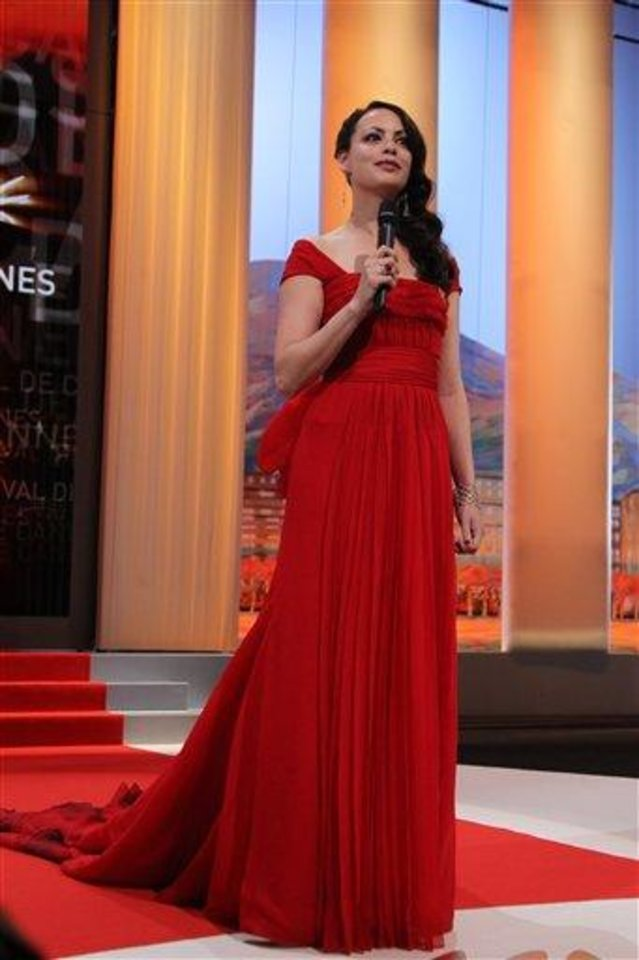 Photo - Actress Berenice Bejo presents during the opening ceremony at the 65th international film festival, in Cannes, southern France, Wednesday, May 16, 2012. (AP Photo/Joel Ryan)