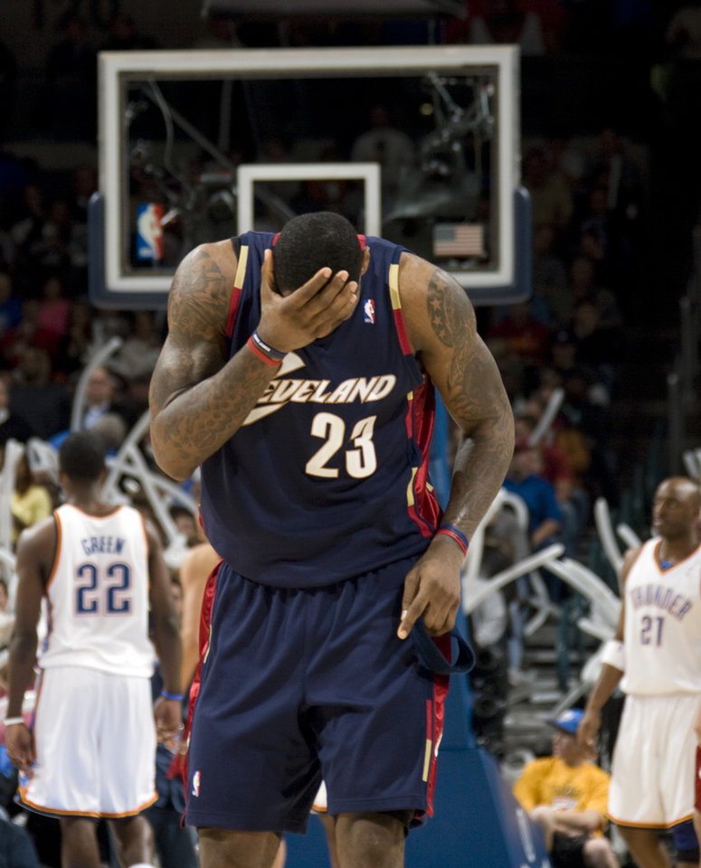 Cleveland\'s LeBron James (23) reacts after getting hit during a play during the NBA game between the Oklahoma City Thunder and Cleveland Cavaliers, Sunday, Dec. 21, 2008, at the Ford Center in Oklahoma City. PHOTO BY SARAH PHIPPS, THE OKLAHOMAN