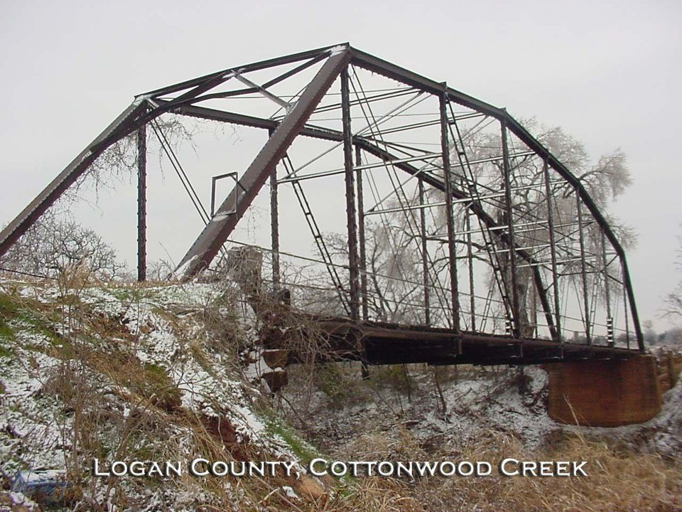 This bridge on Academy Road over Cottonwood Creek in Logan County was constructed in 1920. Declared unsafe by bridge inspectors, it has recently been replaced by a new concrete structure.<br/><b>Community Photo By:</b> Mark Sharpton, Commissioner<br/><b>Submitted By:</b> Mark,