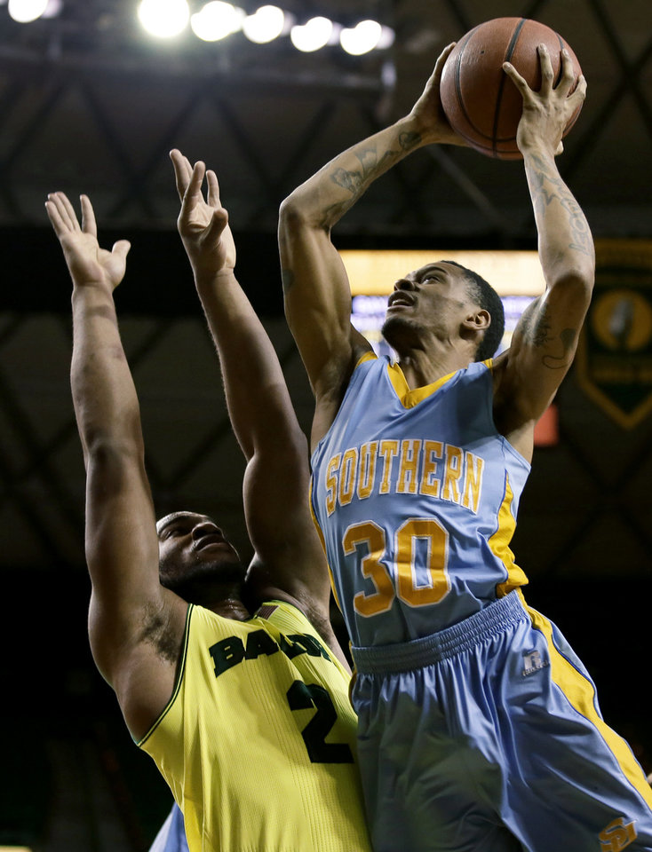 Southern's Tre Lynch (30) goes up for a shot over Baylor's Rico Gathers (2) in the first half of an NCAA college basketball game, Sunday, Dec. 22, 2013, in Waco, Texas. (AP Photo/Tony Gutierrez)