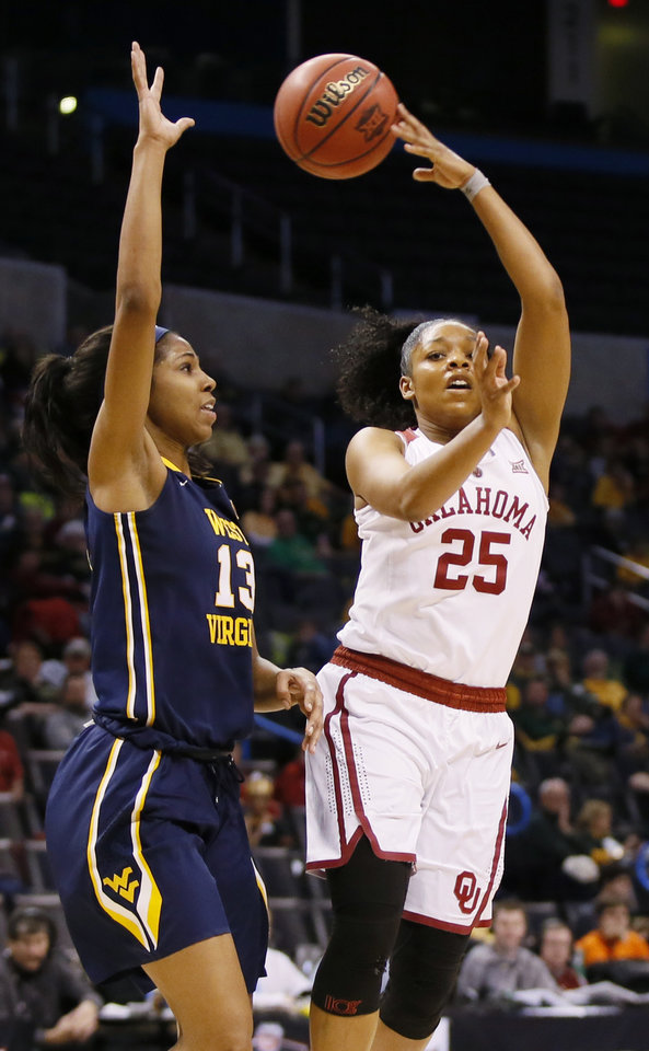 Photo - Oklahoma's Gioya Carter passes away from West Virginia's Kristina King during a college basketball game in the Big 12 Women's Basketball Tournament between the Sooners and West Virginia at Chesapeake Energy Arena in Oklahoma City on March 4, 2017. [Photo by Nate Billings, The Oklahoman]