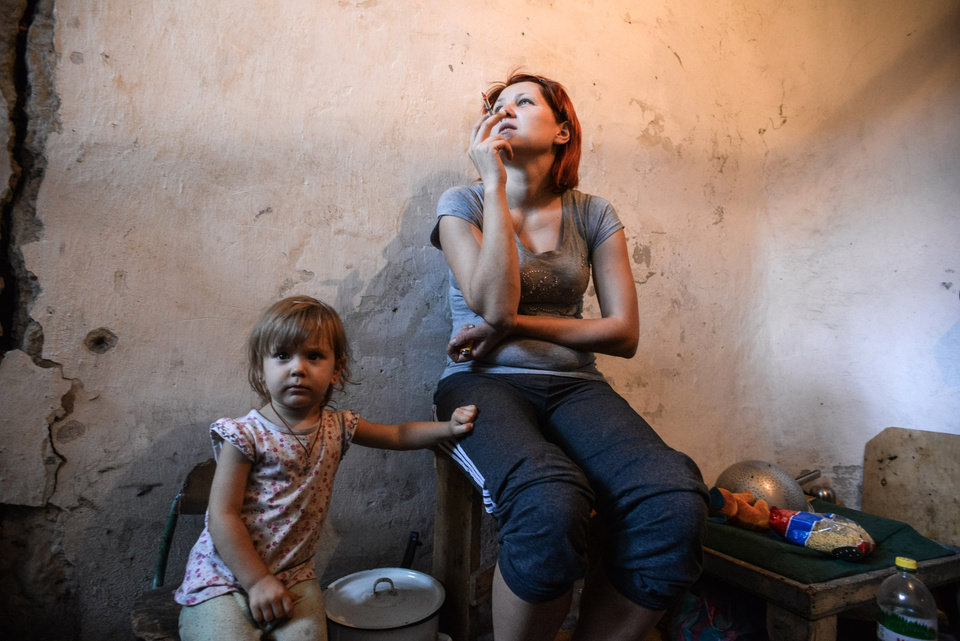 Photo - A mother and child hide in a bomb shelter in Petrovskiy district in Donetsk, eastern Ukraine, Monday, Sept. 1, 2014. The Petrovskiy district of Donetsk is currently a frontline and one of the districts which suffered the most from the artillery fights between Ukrainian army and Pro-Pussian rebels. (AP Photo/Mstislav Chernov)