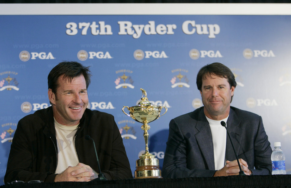 Photo - Ryder Cup captains Nick Faldo, left, of the European squad, and Paul Azinger, of the United States, appear with the Ryder Cup golf trophy at a news conference after the European team arrived in Louisville, Ky., Monday, Sept. 15, 2008. (AP Photo/Ed Reinke) ORG XMIT: KYER107