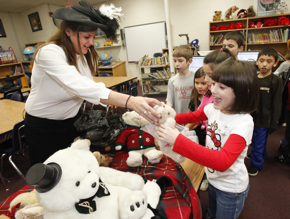CHILD / CHILDREN / KIDS / TEDDY BEAR GIVEAWAY: Marcey Mix gives Courtney Sweet, second grade, a teddy bear at Houchin Elementary School in Moore, Tuesday December, 20,  2011. Photo by Steve Gooch, The Oklahoman