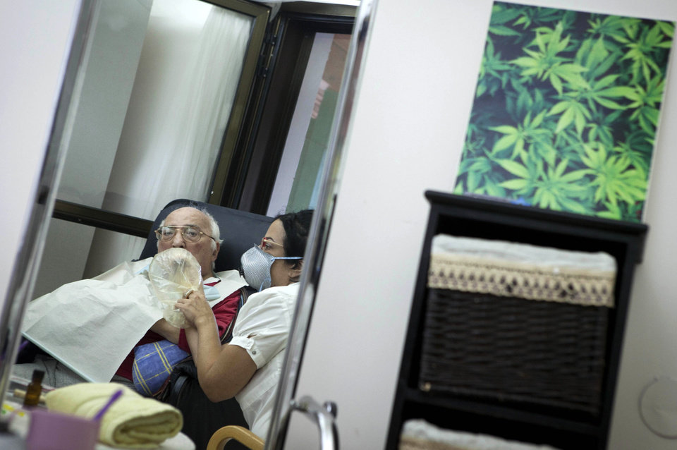Photo -   In this photograph made on Tuesday, Oct. 30, 2012, Rom Germad inhales medical cannabis at the old age nursery home in kibbutz Naan next to the city of Rehovot, Israel. Marijuana is illegal in Israel but medical use has been permitted since the early nineties for cancer patients and those with pain-related illnesses such as Parkinson's, Multiple Sclerosis, and even post-traumatic stress disorder. (AP Photo/Dan Balilty)