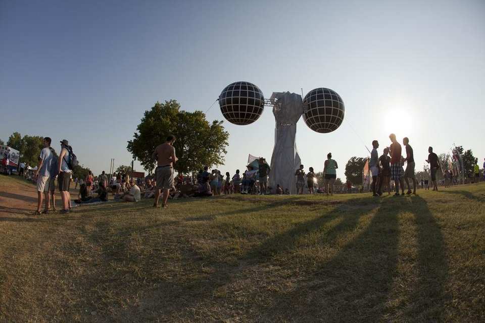 Photo - A strange sculpture towered over the Cottonwood Flats entrance of the main stage of the Gentlemen of Road Stopover on Friday.  Nathan Poppe, for The Oklahoman