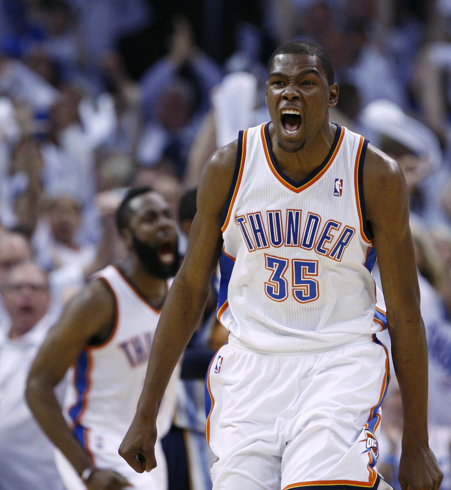 Photo - Oklahoma City Thunder forward Kevin Durant, right, reacts to a dunk by teammate James Harden, left, in the second quarter of Game 5 of a second-round NBA basketball playoff series against the Memphis Grizzlies in Oklahoma City, Wednessday, May 11, 2011. (AP Photo/Alonzo Adams)