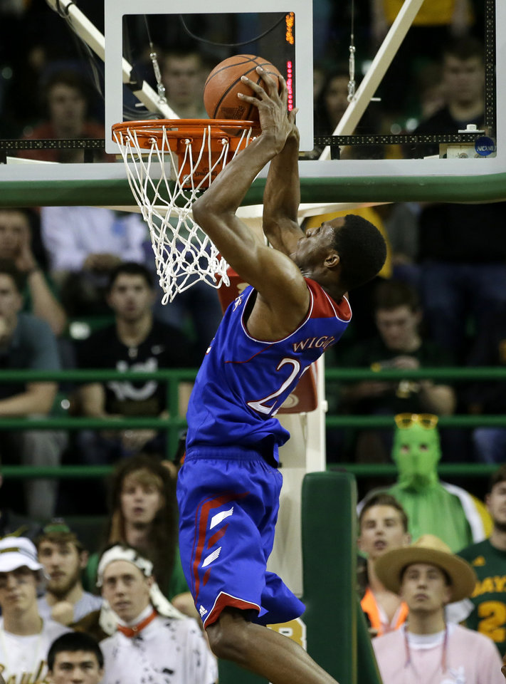 Photo - Kansas guard Andrew Wiggins (22) goes up for a dunk in the second half of an NCAA college basketball game against Baylor, Tuesday, Feb. 4, 2014, in Waco, Texas. Wiggins scored 14-points in the 69-52 Kansas win.  (AP Photo/Tony Gutierrez)