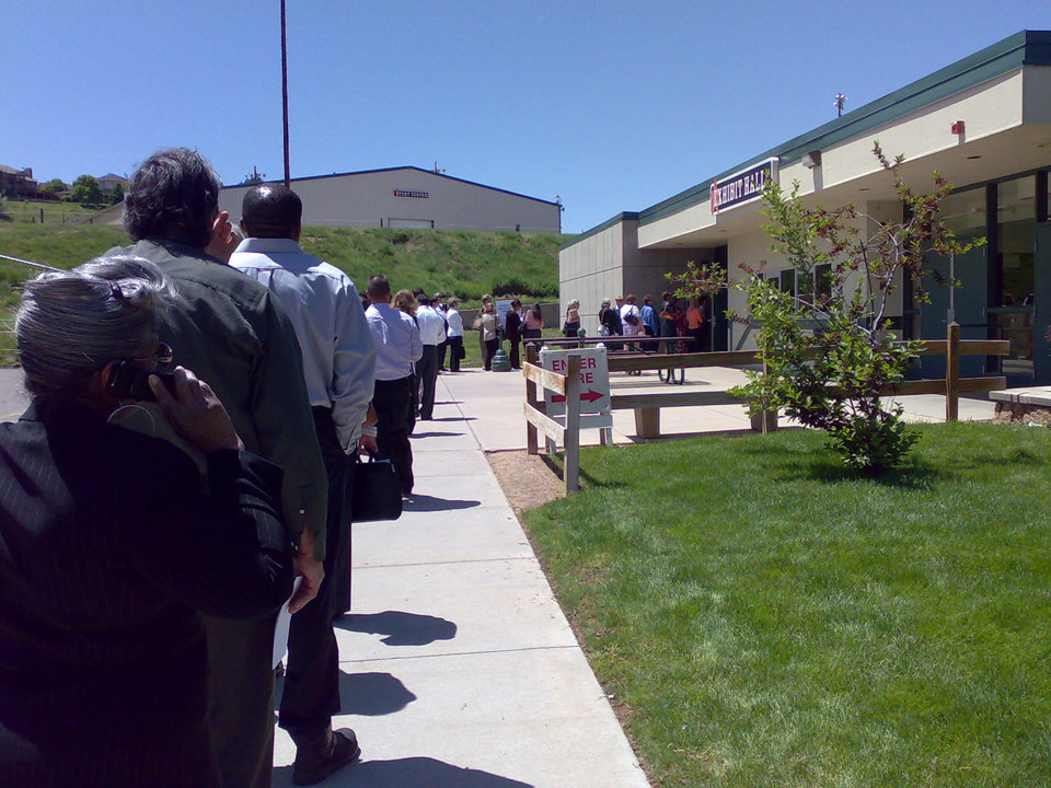 Photo -       More Boomers than Millennials lined up for this job fair in May of 2012.