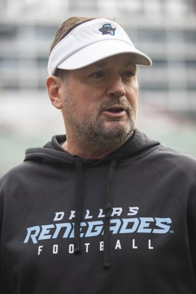 Photo -  Dallas Renegades coach Bob Stoops answers questions from reporters before a practice in January. [Courtesy Dallas Morning News]