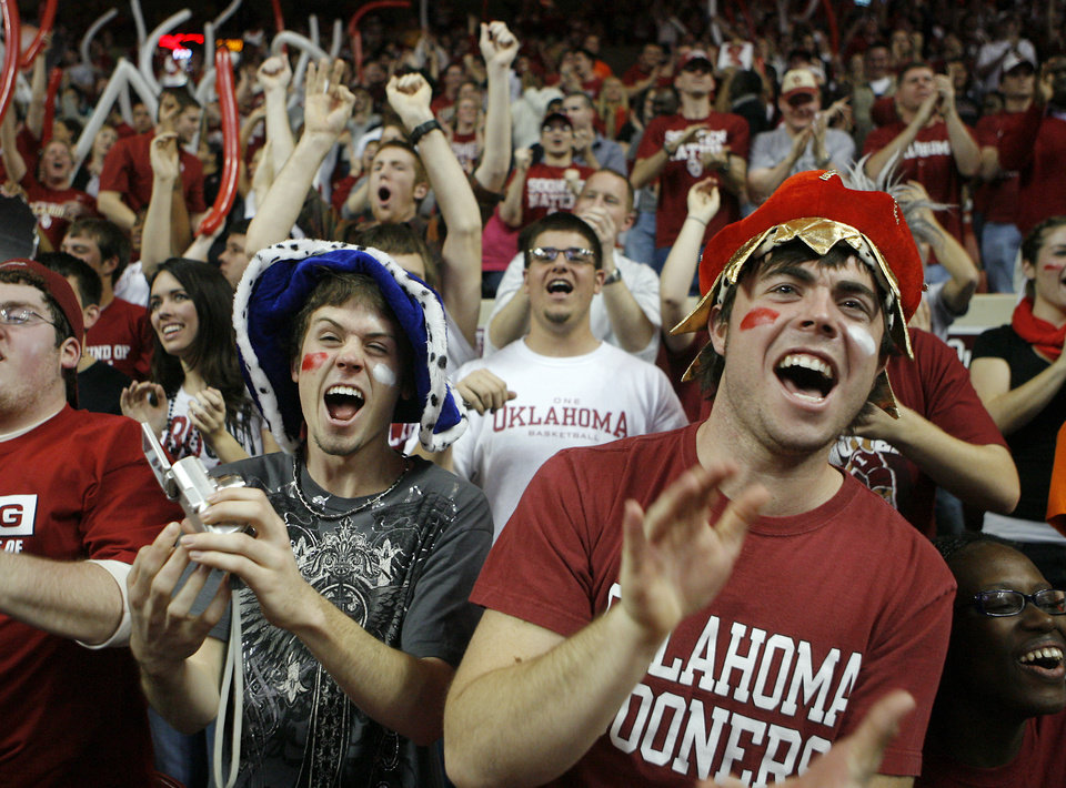 Photo - OU sophomores Kyle Klish and Austin Saunders cheer on the Sooners during the second half of the college bedlam basketball game between The University of Oklahoma Sooners (OU) and Oklahoma State University University Cowboys (OSU) at the Lloyd Noble Center on Monday, Jan. 11, 2010, in Norman, Okla.