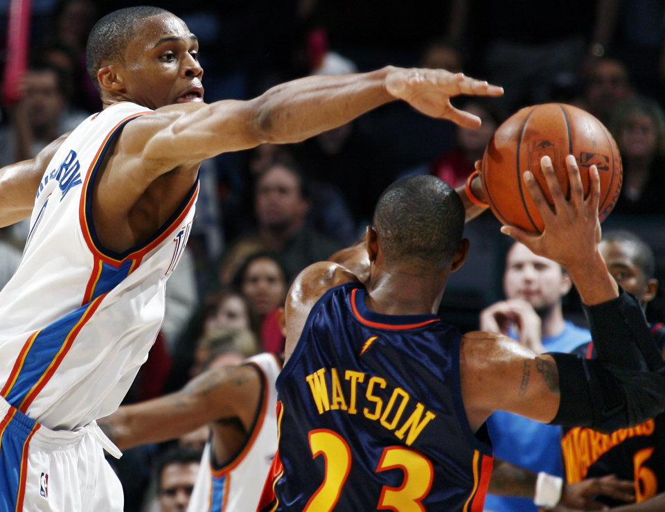 Photo - Oklahoma City's Russell Westbrook defends C.J. Watson of Golden State in the second half during the NBA basketball game between the Golden State Warriors and the Oklahoma City Thunder at the Ford Center in Oklahoma City, Monday, December 8, 2008. Golden State won, 112-102.  BY NATE BILLINGS, THE OKLAHOMAN