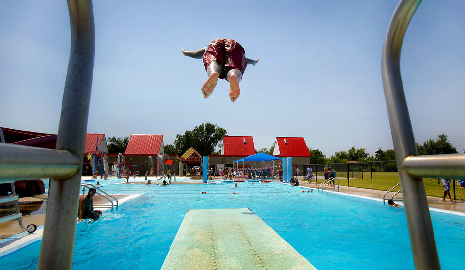 LeRon Taylor, 15, takes a dive into the cool blue waters of Eagle Harbor Water Park on Tuesday, Aug. 4, 2009, in Del City, Okla.   Photo by Chris Landsberger, The Oklahoman