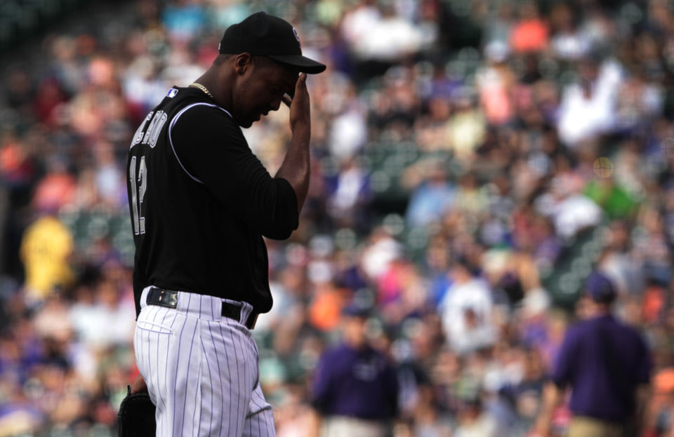 Photo - Colorado Rockies starting pitcher Juan Nicasio walks to the dugout in the first inning of a baseball game against the Atlanta Braves in Denver on Tuesday, June 10, 2014. The Braves scored seven runs off Nicasio in the inning. (AP Photo/Joe Mahoney)