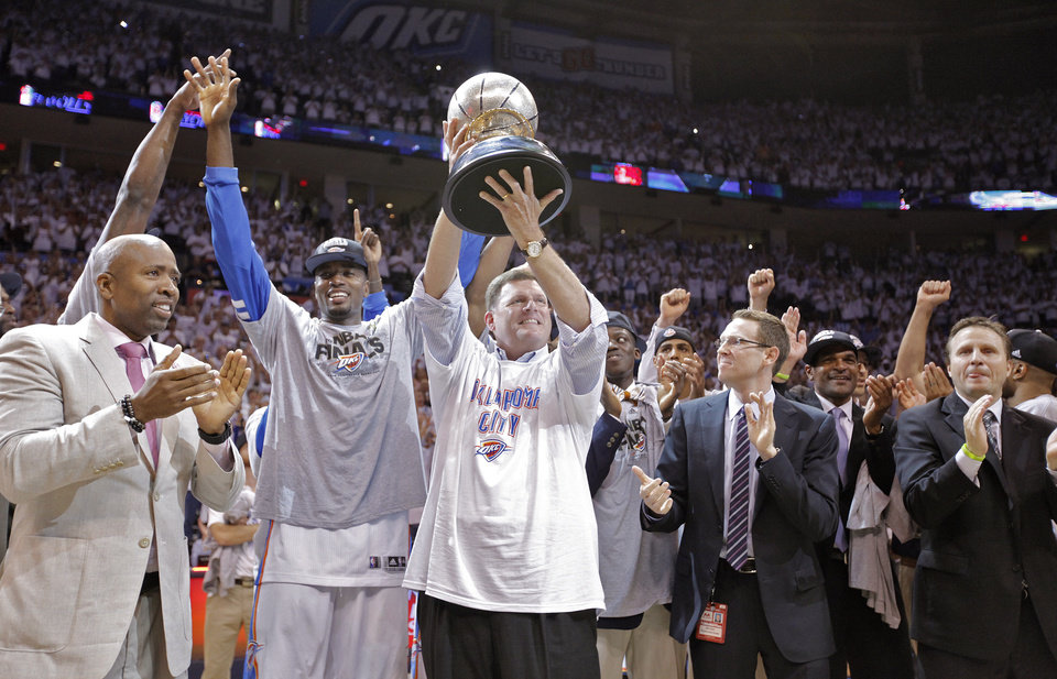 Oklahoma City Thunder chairman Clay Bennett celebrates with the Western Conference Championship Trophy after the Thunder's 107-99 win over the Spurs in Game 6 of the Western Conference Finals between the Oklahoma City Thunder and the San Antonio Spurs in the NBA playoffs at the Chesapeake Energy Arena in Oklahoma City, Wednesday, June 6, 2012. Photo by Chris Landsberger, The Oklahoman
