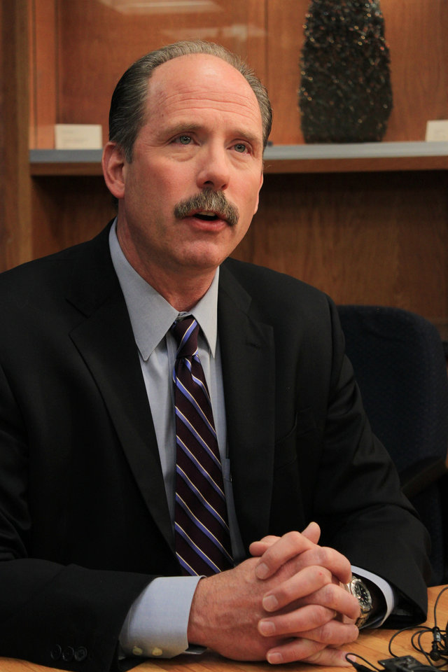 Photo - Albuquerque Mayor Richard Berry discusses the city's response to a hourslong protest over police shootings during a news conference in Albuquerque, N.M. on Monday, March 31, 2014. (AP Photo/Susan Montoya Bryan)