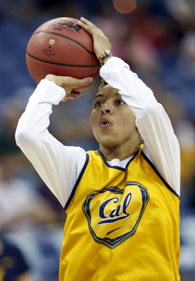 Photo - California guard Layshia Clarendon shoots during practice at the Women's Final Four of the NCAA college basketball tournament, Saturday, April 6, 2013, in New Orleans. California plays Louisville in a national semifinal on Sunday. (AP Photo/Dave Martin)