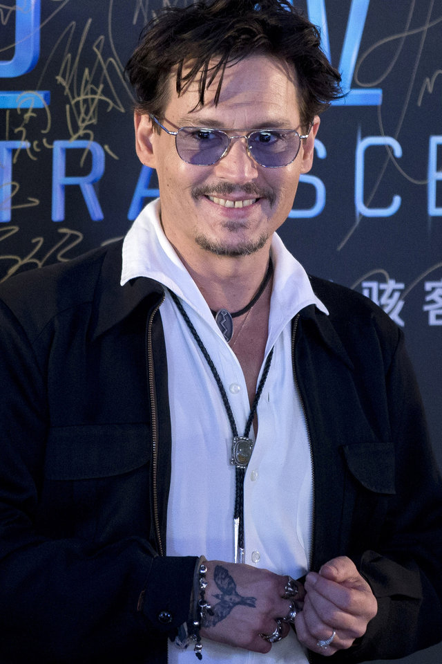 """Photo - Actor Johnny Depp attends a promotional event for his new movie """"Transcendence"""" in Beijing, China, Monday, March 31, 2014.  Depp showed off a diamond engagement ring that he called a """"chick's ring"""" on Monday, indirectly confirming rumors of his engagement to actress Amber Heard. (AP Photo/Alexander F. Yuan)"""