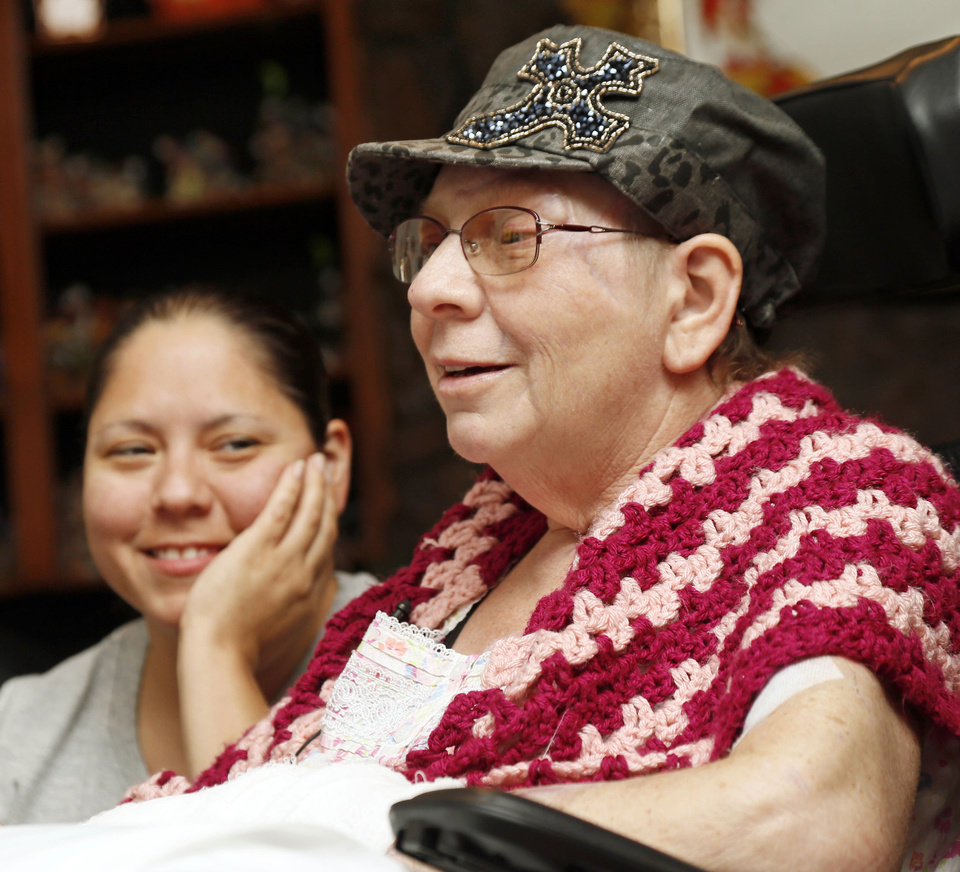 Daughter Christina Morales listens with a smile to her mother, Edith Morales, after she spent 125 days in hospitals and rehab centers. Her daughter and sisters have been at her side since the May 20 Moore tornado. PHOTO BY NATE BILLINGS, THE OKLAHOMAN. <strong>NATE BILLINGS</strong>
