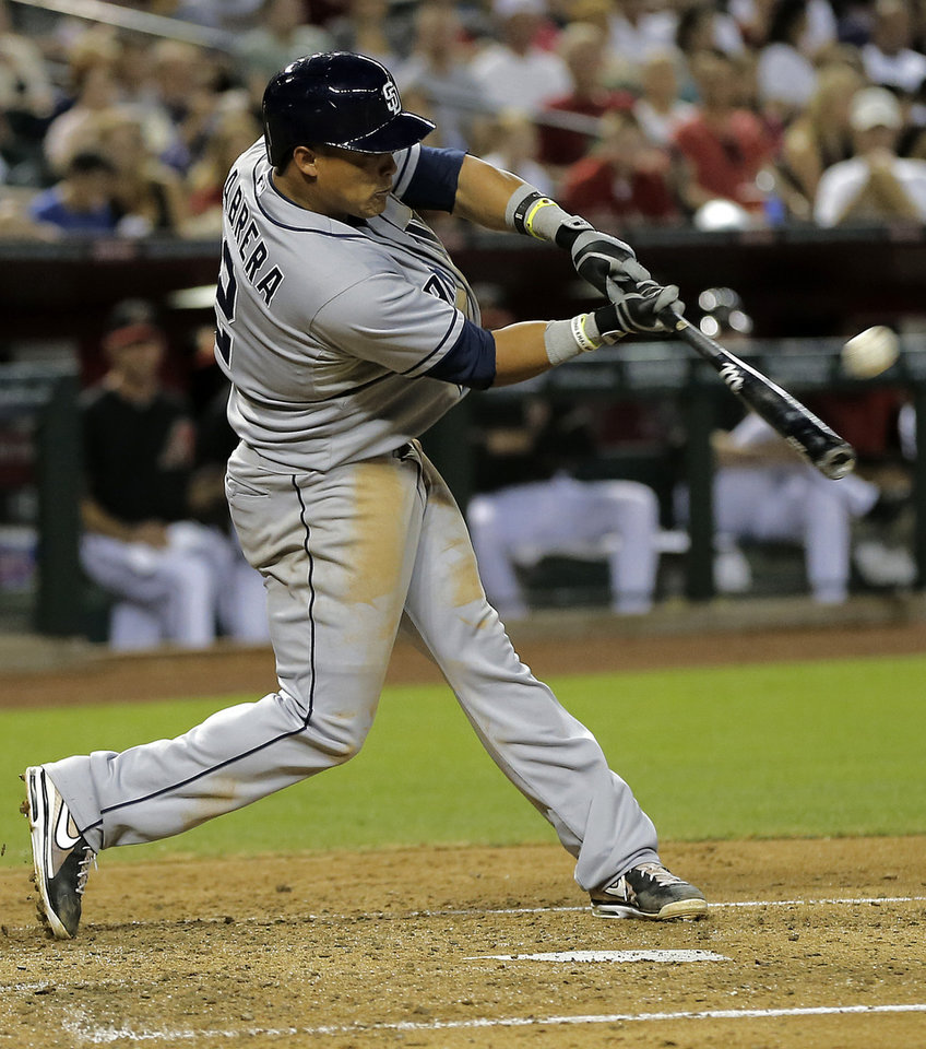 San Diego Padres' Everth Cabera connects for a two-run home run against the Arizona Diamondbacks during the third inning of a baseball game on Saturday, May 25, 2013, in Phoenix. (AP Photo/Matt York)