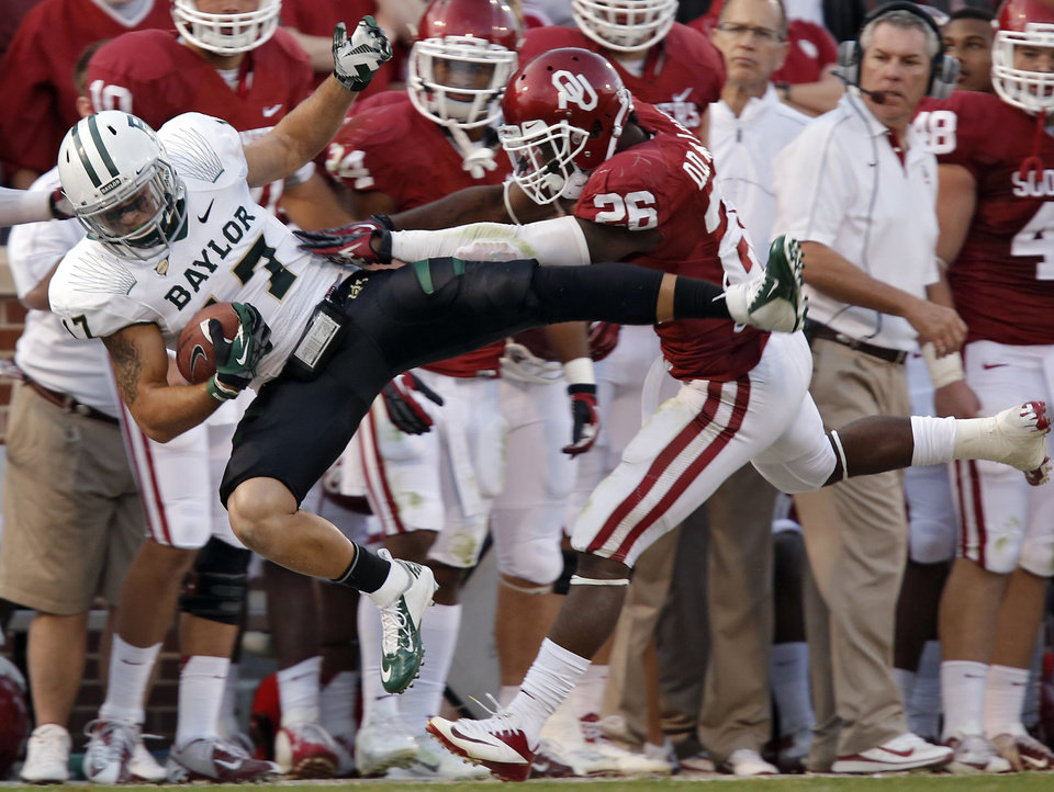 Oklahoma's Damien Williams (26) forces Baylor's Mike Hicks (17) out of bounds after an interception during the college football game between the University of Oklahoma Sooners (OU) and Baylor University Bears (BU) at Gaylord Family - Oklahoma Memorial Stadium on Saturday, Nov. 10, 2012, in Norman, Okla.  Photo by Chris Landsberger, The Oklahoman