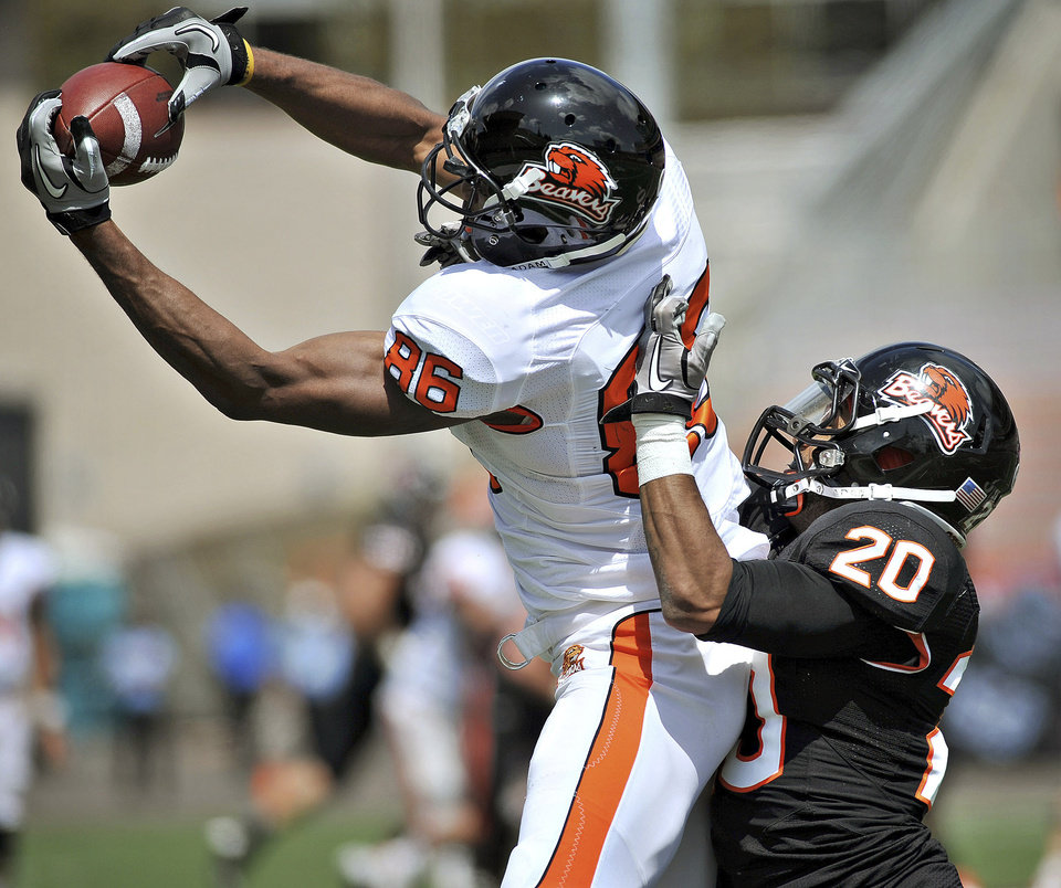 Photo -   Oregon State receiver Obum Gwacham catches a pass while defended by cornerback Keynan Parker during their spring NCAA college football game, Saturday, April 28, 2012, in Corvallis, Ore. (AP Photo/The Corvallis Gazette-Times, Andy Cripe) MAGS OUT