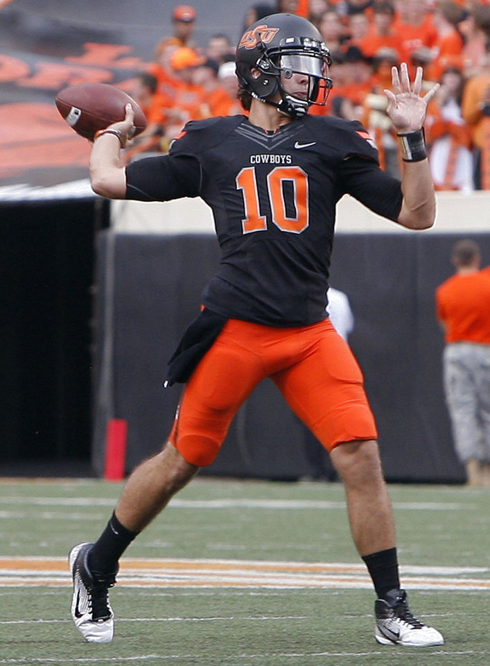 Oklahoma State's Clint Chelf (10) passes during the first half of the college football game between the Oklahoma State University Cowboys (OSU) and the University of Kansas Jayhawks (KU) at Boone Pickens Stadium in Stillwater, Okla., Saturday, Oct. 8, 2011. Photo by Sarah Phipps, The Oklahoman