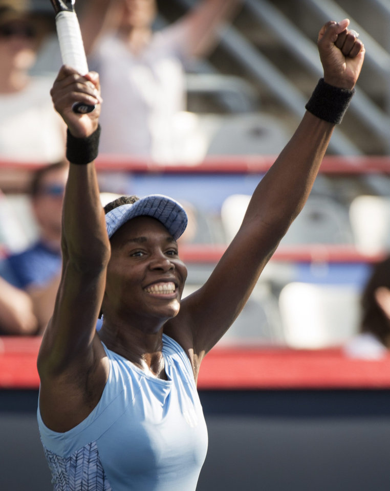 Photo - Venus Williams celebrates her victory over Carla Suarez Navarro from Spain at the Rogers Cup tennis tournament, Friday, Aug. 8, 2014 in in Montreal. (AP Photo/The Canadian Press, Paul Chiasson)