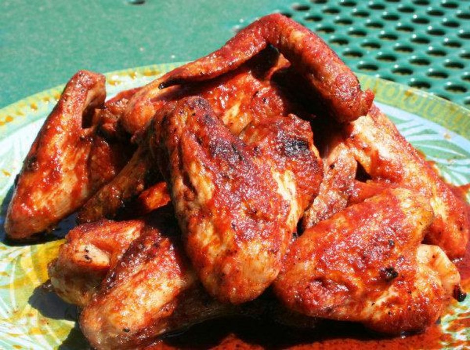 These grilled chicken wings are mixed with a sauce made of melted butter and hot sauce. <strong> - THE OKLAHOMAN</strong>
