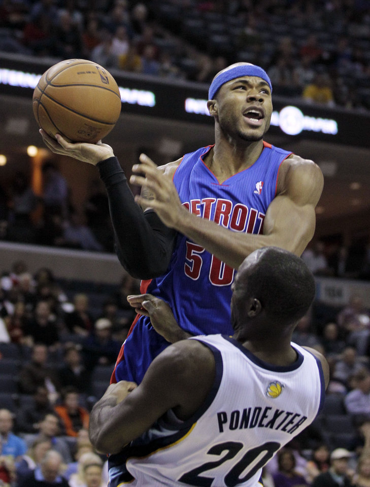 Photo - Detroit Pistons' Corey Maggette (50) is fouled by Memphis Grizzlies' Quincy Pondexter (20) during the first half of an NBA basketball game in Memphis, Tenn., Friday, Nov. 30, 2012. (AP Photo/Danny Johnston)