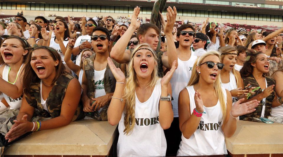 Photo - Norman North fans cheer as their Timberwolves play the Norman High School Tigers at Gaylord Family-Oklahoma Memorial Stadium in Norman, Okla., on Thursday, Sept. 5, 2013. Photo by Steve Sisney, The Oklahoman