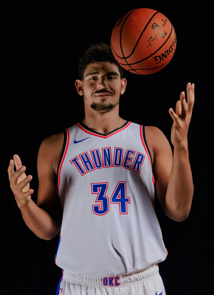 Photo - Tyler Davis poses for a photo during media day at the Chesapeake Energy Arena in Oklahoma City, Okla. on Monday, Sept. 24, 2018. Photo by Chris Landsberger, The Oklahoman