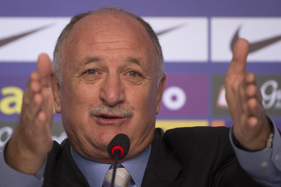 Photo - Brazil's soccer coach Luiz Felipe Scolari announces his list of players for the 2014 Soccer World Cup during a news conference in Rio de Janeiro, Brazil, Wednesday, May 7, 2014. The team will mix talented young stars such as Neymar and Oscar with more experienced players such as Dani Alves, David Luiz, Thiago Silva and Hulk.(AP Photo/Felipe Dana)