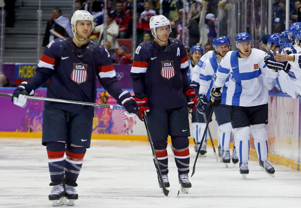 Photo - Team Finland celebrates a second period goal against the USA during the men's bronze medal ice hockey game at the 2014 Winter Olympics, Saturday, Feb. 22, 2014, in Sochi, Russia. (AP Photo/Petr David Josek)