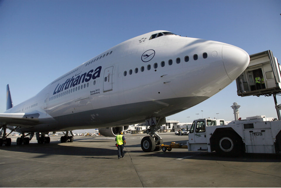 FILE - In this Monday, Dec. 10, 2012, file photo, Lufthansa's Boeing 747-8 Brandenburg aircraft arrives at Los Angeles International Airport, after its inaugural passenger flight from Frankfurt, Germany to Los Angeles. Boeing Co. said on Thursday, Jan. 3, 2013, that it delivered 601 planes last year, putting it on track to beat European rival Airbus as the top plane maker for the year. Airbus has beaten Boeing in deliveries in recent years, but Boeing is now cranking out its new 787 and a revamped 747 after delays for both aircraft. (AP Photo/Nick Ut, File)