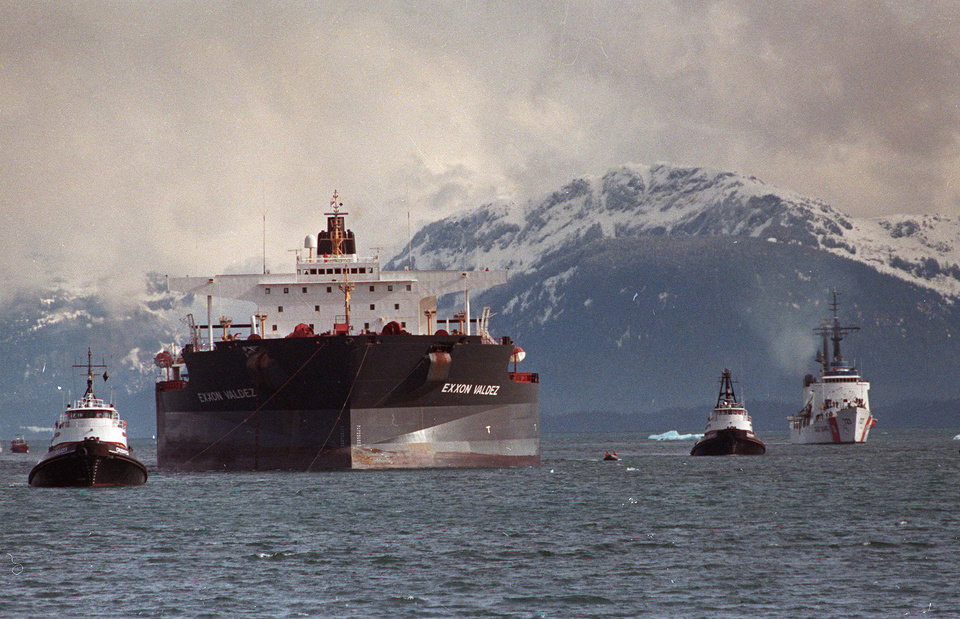 "FILE - In this June 23, 1989 file photo, the Exxon Valdez is towed out of Prince William Sound in Alaska by a tug boat and a U.S. Coast Guard Cutter. India's Supreme Court on May 3, 2012 banned the Exxon Valdez from entering India, saying the ship involved in one of the worst U.S. oil spills will not be allowed in for dismantling until it has been decontaminated. The ship, now known as the ""Oriental Nicety,"" entered Indian waters last week and was headed for the western Indian state of Gujarat for dismantling, when the Supreme Court gave its order, environmental activist Gopal Krishna said Wednesday. (AP Photo/Al Grillo, File)"
