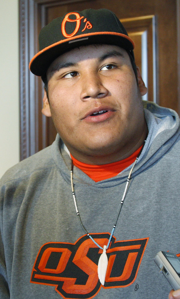 This Oct. 24, 2011, photo shows Oklahoma State defensive tackle Christian Littlehead during an interview in Stillwater, Okla. Oklahoma State has been winning with a defense that ranks 103rd in the country, making up for it with a prolific scoring offense and by leading the nation in turnover margin.  (AP Photo/Sue Ogrocki) ORG XMIT: OKSO108