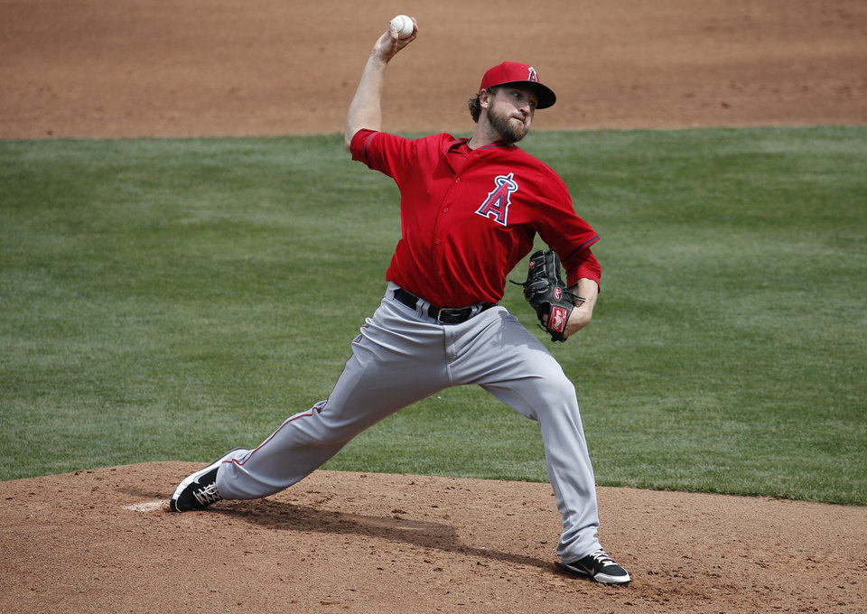 Photo - Los Angeles Angels pitcher Brandon Lyon throws against the Chicago Cubs' during the second inning of a spring training baseball game, Tuesday, March 25, 2014, in Mesa, Ariz. (AP Photo/Matt York)