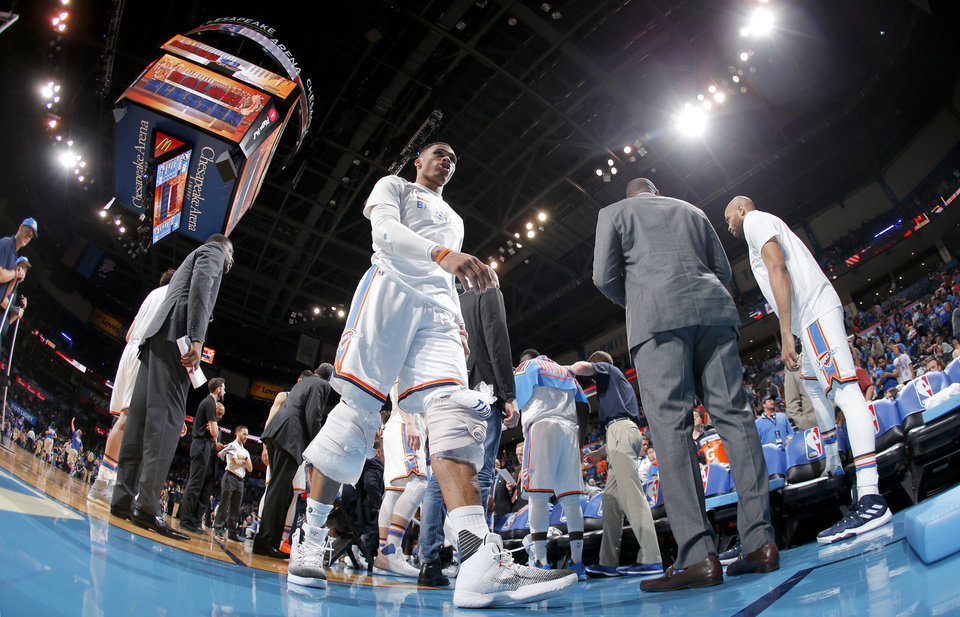 Photo - Oklahoma City's Russell Westbrook (0) walks off the court during a timeout in an NBA basketball game between the Oklahoma City Thunder and the Milwaukee Bucks at Chesapeake Energy Arena in Oklahoma City, Tuesday, April 4, 2017. Photo by Bryan Terry, The Oklahoman