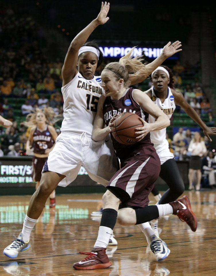Photo - California's Brittany Boyd (15) defends against a drive to the basket by Fordham's Erin Rooney in the second half of a first-round game in the NCAA women's college basketball tournament, Saturday, March 22, 2014, in Waco, Texas. (AP Photo/Tony Gutierrez)